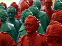 Johann Wolfgang von Goethe plastic statues, designed by Ottmar Hoerl stand in front of the Goethe University in Frankfurt