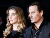 FILE: Amber Heard And Johnny Depp Finalize Divorce