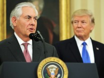 New U.S. Secretary of State Rex Tillerson speaks after his swearing-in ceremony, accompanied by U.S. President Donald Trump at the Oval Office of the White House in Washington, DC
