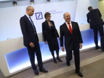 Deutsche Bank CEO Cryan arrives for the bank's annual news conference in Frankfurt