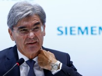 FILE PHOTO: Siemens CEO Kaeser reacts during annual news conference in Munich