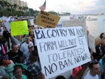 Protest against executive orders outside Trump Plaza Hotel in West Palm  Beach, Florida