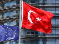 A European Union and Turkish flag fly outside a hotel in Istanbul