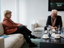 U.S. actor Richard Gere and German Chancellor Angela Merkel talk at the Chancellery in Berlin