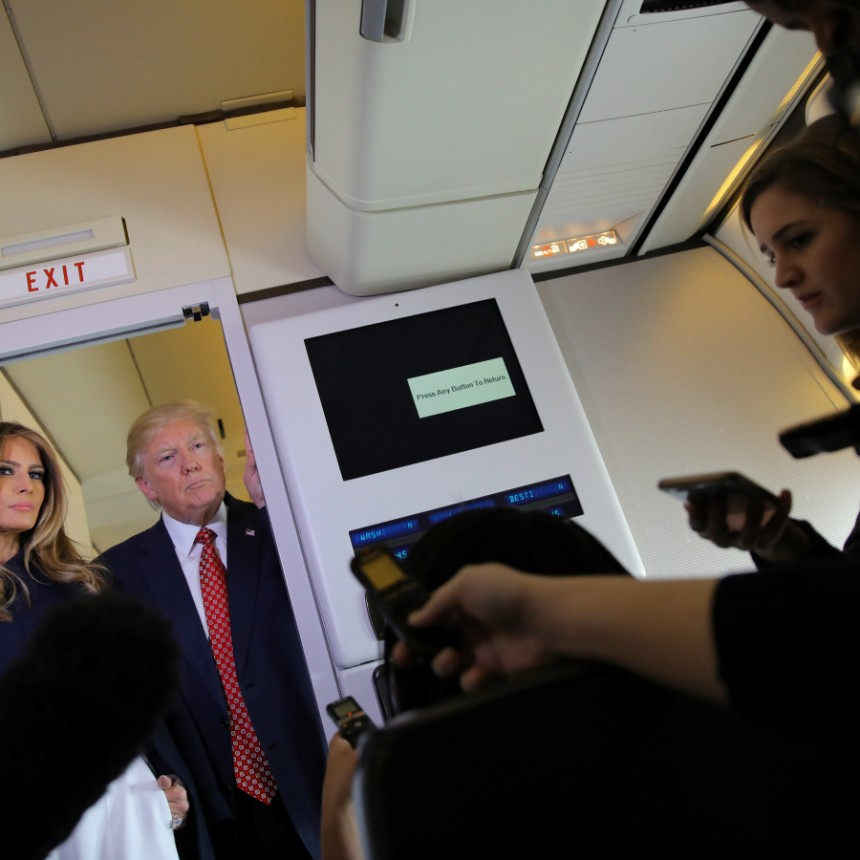 U.S. President Donald Trump talks to journalist members of the travel pool accompanied by First Lady Melania Trump on board of the Air Force One during his trip to Palm Beach, Florida, U.S.
