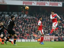 Arsenal s Mesut Ozil puts his shot over the bar during the Premier League match at the Emirates Stad