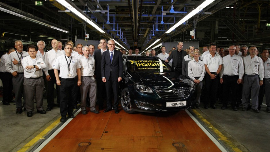 Neumann Chief Executive of carmaker Adam Opel AG and members of staff pose next to a facelifted Opel 'Insignia' inside the assembly hangar of Opel in Ruesselsheim