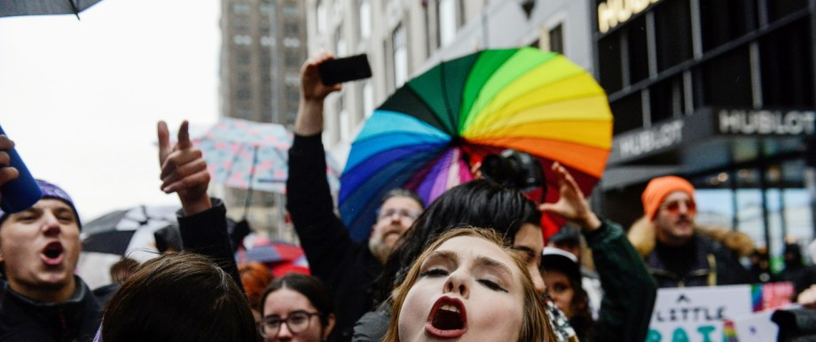 People participate in a kiss-in protest against U.S. President Donald Trump organized by the LGBT community near Trump Tower in New York City