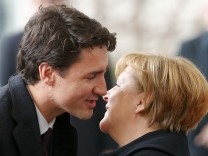 German Chancellor Angela Merkel welcomes Canada's Prime Minister Justin Trudeau at the Chancellery in Berlin