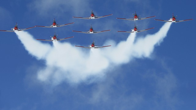 Members of the Swiss aerobatic team Patrouille Swiss fly in formation over the valley of St. Moritz during an airshow for the FIS Alpine World Skiing Championships in St. Moritz