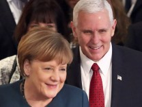 German Chancellor Merkel walks with U.S. Vice President Pence during the 53rd Munich Security Conference in Munich