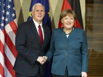 German Chancellor Merkel poses for a picture with U.S. Vice President Pence before their meeting at the 53rd Munich Security Conference in Munich