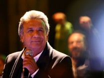 Lenin Moreno, candidate of the ruling PAIS Alliance Party, celebrates the early results of the presidential election with supporters in Quito