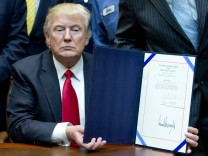 United States President Donald J Trump signs H J Res 38 disapproving the rule submitted by the U