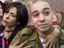 Israeli soldier Elor Azaria is embraced by his mother at the start of is sentencing hearing at a military court in Tel Aviv, Israel