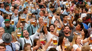 Visitors cheer with beer during the opening day of the 183rd Oktoberfest in Munich
