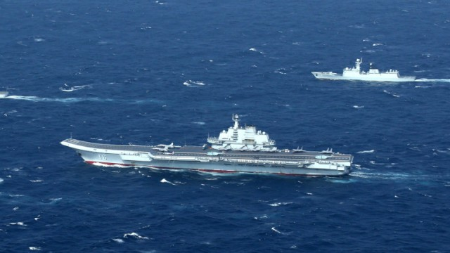 FILE PHOTO: China's Liaoning aircraft carrier with accompanying fleet conducts a drill in an area of South China Sea