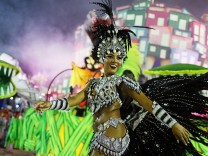 A reveller from the Paraiso do Tuiuti samba school performs during the carnival parade at the Sambadrome in Rio de Janeiro
