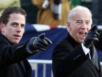 File photo of U.S. Vice President Biden and son Hunter gesturing as they walk down Pennsylvania Avenue