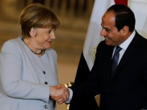 Egypt's President Abdel Fattah al-Sisi and German Chancellor Angela Merkel shake hands following a news conference at the El-Thadiya presidential palace in Cairo