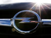 An Opel logo is seen on a car in Bordeaux