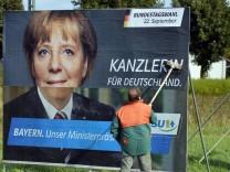 Angela Merkel auf einem Wahlplakat, 2013