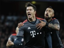 Bayern Munich's Robert Lewandowski celebrates scoring their first goal with Arturo Vidal