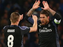Real Madrid's Sergio Ramos celebrates scoring their first goal with Toni Kroos