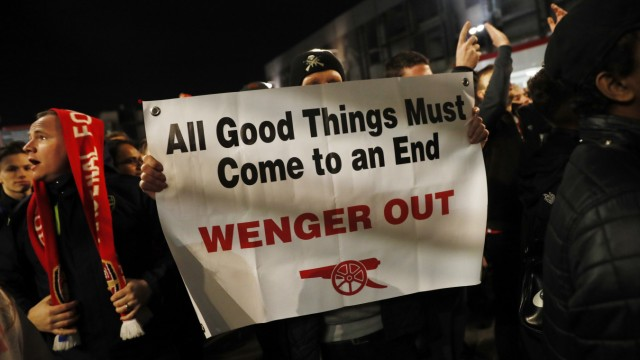 Fans protest against Arsenal manager Arsene Wenger outside the stadium before the match