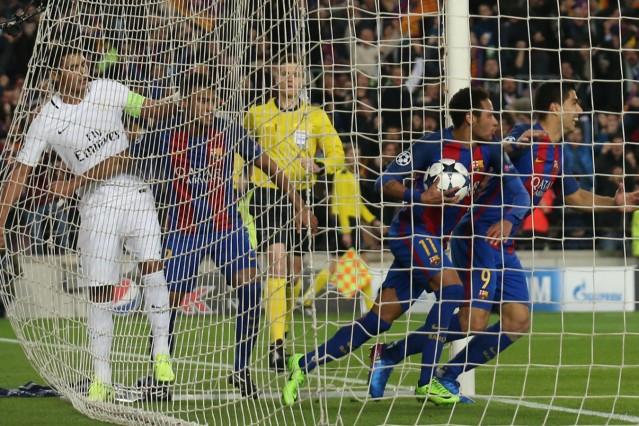 Barcelona's Neymar and Luis Suarez celebrates after Paris Saint-Germain's Layvin Kurzawa scored an own goal and their second goal
