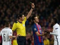 Paris Saint-Germain's Blaise Matuidi is shown a yellow card by referee Deniz Aytekin