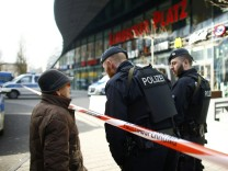Police talk to a woman at the entrance of Limbecker Platz shopping mall in Esse