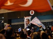 Demonstrators gather ahead of clashes with riot police outside the Turkish consulate in Rotterdam