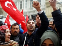 People shout slogans during a protest in front of the Dutch Consulate in Istanbul