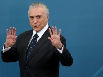 Brazil's President Michel Temer gestures during a ceremony at the Planalto Palace in Brasilia