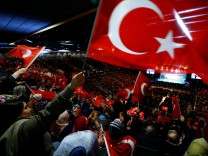 FILE PHOTO:  People wave flags during the speech of Turkish Prime Minister Yildirim in Oberhausen