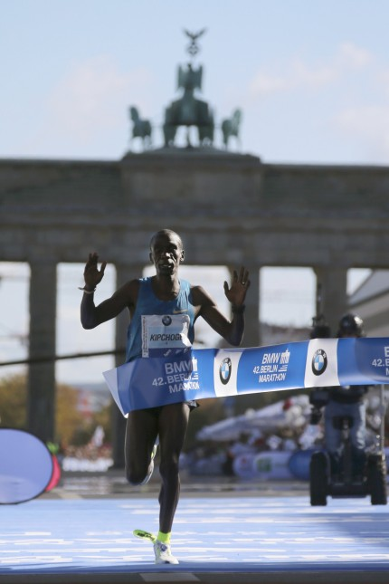 Kenya's Kipchoge crosses the finish line to win the men's 42nd Berlin marathon