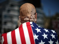 Mike Stutz is seen with his head covered in band aids to protest against President Trump's proposed replacement for Obamacare in Los Angeles