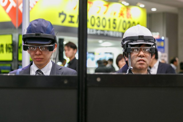 Visitors test Epson smart glasses Moverio Pro BT 2000 at the Wearable Expo in Tokyo Big Sight on Jan