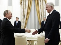 Russian President Putin greets Bavarian PM Seehofer during their meeting at Kremlin in Moscow