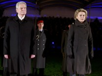 German Defence Minister Ursula von der Leyen, Joachim Gauck and Chief of Staff of the German Armed Forces Bundeswehr Volker Wieker attend a Grand Tattoo to bid farewell to former German President Joachim Gauck at the presidential Bellevue palace in Berlin