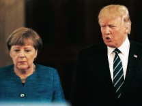 U.S. President Trump and German Chancellor Merkel arrive to give a joint news conference in Washington