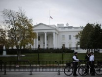 Uniformed U.S. Secret Service officers keep watch outside the White House in Washington