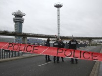 Police officers cordon off the access to the Orly airport, south of Paris, Saturday, March, 18, 2017.