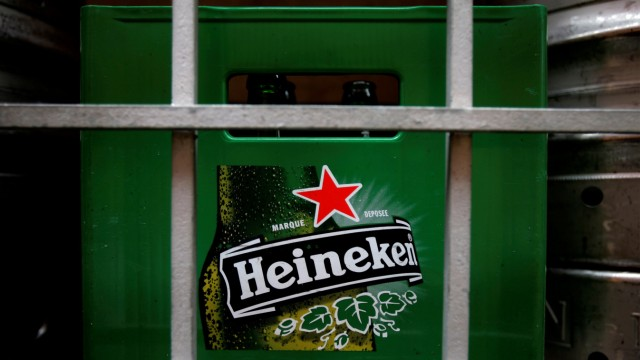 FILE PHOTO: A plastic container with empty bottles of Heineken beers are pictured among beer kegs outside a restaurant in Singapore
