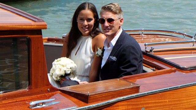 German football player Schweinsteiger and Serbian tennis player Ivanovic sit in a boat after get married in Venice
