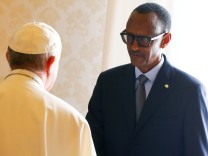 Rwanda's President Paul Kagame greets Pope Francis during a private meeting at the Vatican