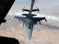 US Air Force F-16 receives fuel from fuel boom suspended from US Air Force KC-10 Extender during mid-air refueling support to Operation Inherent Resolve over Iraq and Syria air space