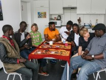 Asylbewerber und Helferkreis
