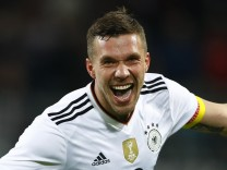 Germany's Lukas Podolski celebrates scoring their first goal